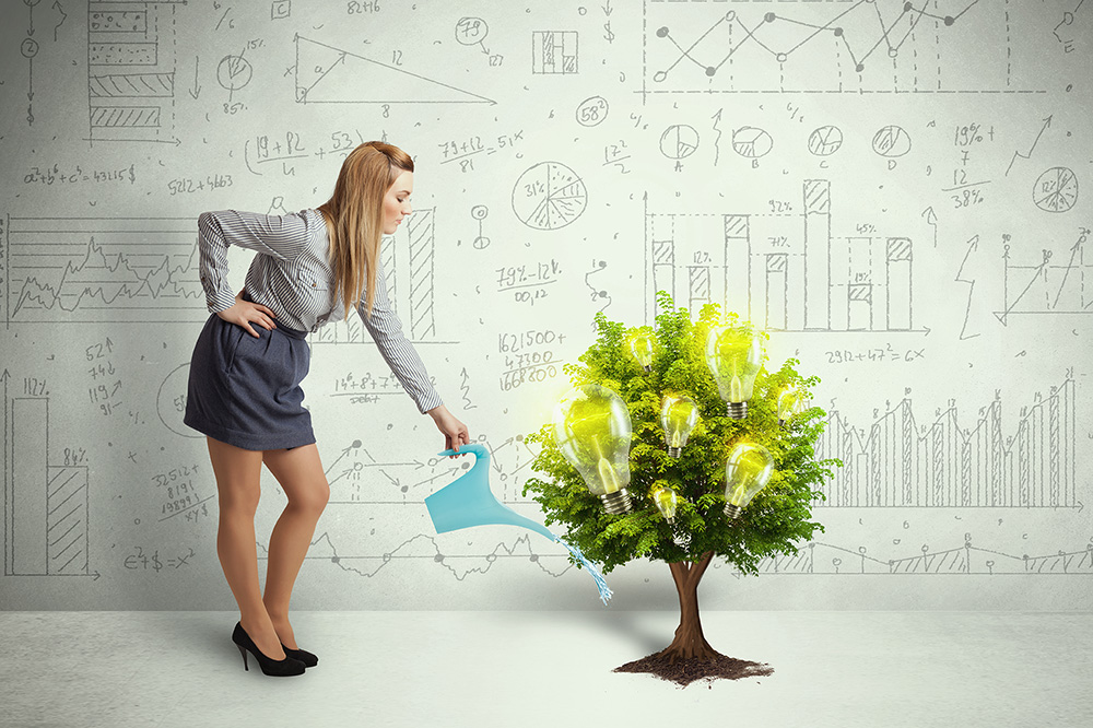 Business woman pouring water on growing tree concept
